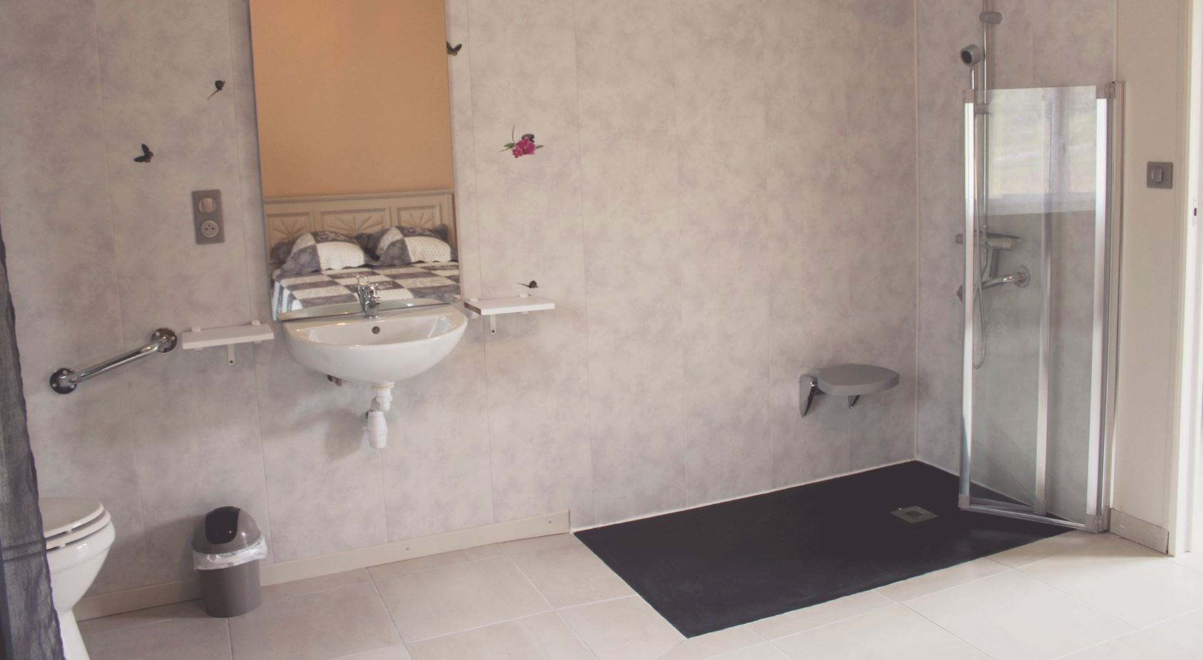 Wheelchair accessible shower room with an Italian shower, wash basin and toilet